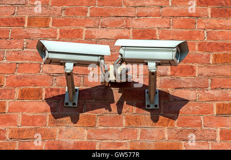 Surveillance cameras mounted on the wall of the building - Stock Photo