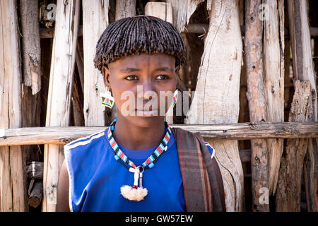 Portrait of a woman of the Bana tribe in traditional dress of the Omo Valley in southern Ethiopia - Stock Photo