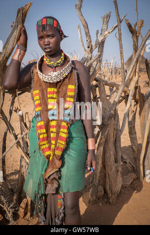 Portrait of a young woman of the Hamer tribe in the Omo Valley of southern Ethiopia dressed in tribal dress of beads - Stock Photo