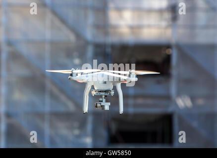 Multicopter, drone, with camera, in flight, DJI Phantom 3 model, - Stock Photo