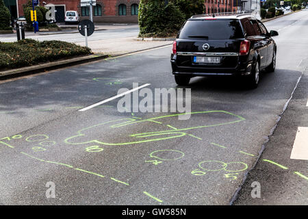 Marks of the police at a traffic accident site, a woman with a bicycle, was hit by a car on a crosswalk and died, - Stock Photo
