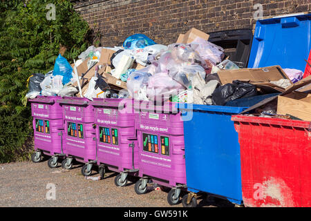 Overflowing mixed recycling bins in Limehouse, Tower Hamlets, London - Stock Photo