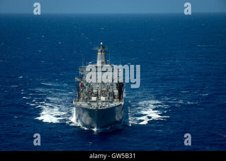 US Navy Military Sealift Command fleet replenishment oiler USNS Henry J. Kaiser steams in close formation during - Stock Photo