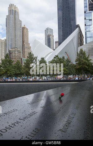 North reflecting pool at the 9/11 Memorial site in Manhattan. - Stock Photo