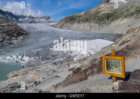 Receding Rhone glacier seen from the point the glacier extended to in 1996, marked with a sign. Obergoms, Valais, - Stock Photo