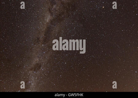 The Milky Way is the galaxy that contains our Solar System. Its name 'milky' is derived from its appearance as a dim glowing ban Stock Photo