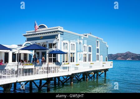 Sausalito, USA - September 23, 2015: A restaurant on stilts in the waterfront of the country - Stock Photo