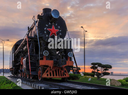 Old Soviet locomotive on the boulevard in Baku.Azerbaijan - Stock Photo