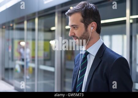 Businessman commuter traveling in the metro underground station - Stock Photo