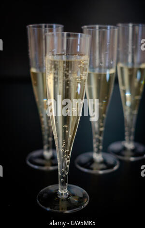 Champagne flutes glasses isolated on black background - Stock Photo