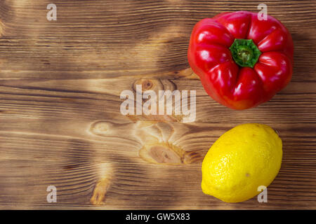 Vegetable wooden background for postcard with red pepper and yellow lemon - Stock Photo