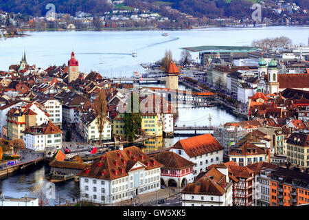Aerial view of the red tiled roofs of the old town of Lucerne, wooden Chapel bridge, stone Water tower, Reuss river - Stock Photo