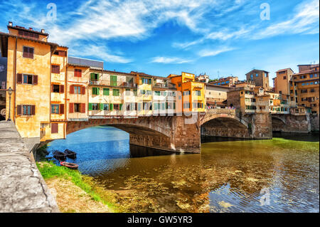 The Ponte Vecchio, or Old Bridge, is a medieval stone arched bridge over Arno river in Florence, Italy - Stock Photo