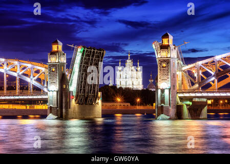 Peter the Great Bridge and Smolny Cathedral at summer white night time, St Petersburg, Russia - Stock Photo