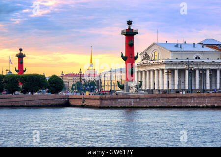 Old Saint Petersburg Stock Exchange, Rostral Columns and golden spire of Admiralty Building at Neva river on sunset, - Stock Photo