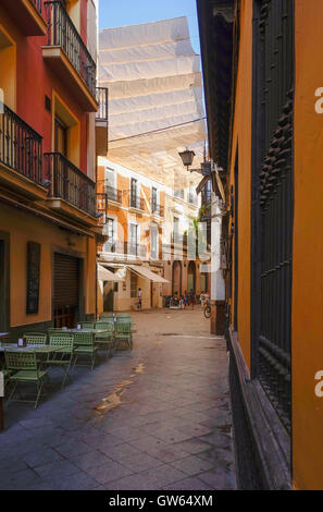 Velas Canopies providing Shade in historic centre Santa Cruz Seville Andalucia & Typical velasu0027u0027 or canopies for shading the narrow city streets ...