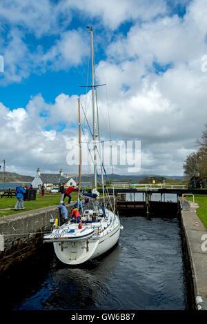 A yacht in Lock 14 at Crinan basin, on the Crinan Canal at Crinan, Argyll and Bute, Scotland, UK - Stock Photo