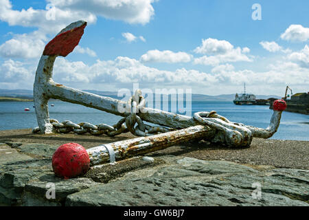 Old anchor on the harbour wall at Ardrishaig, Argyll and Bute, Scotland, UK - Stock Photo
