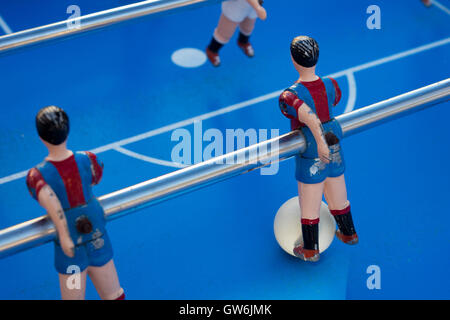 Detail of  figure of table football players, painted with red and blue stripes - Stock Photo