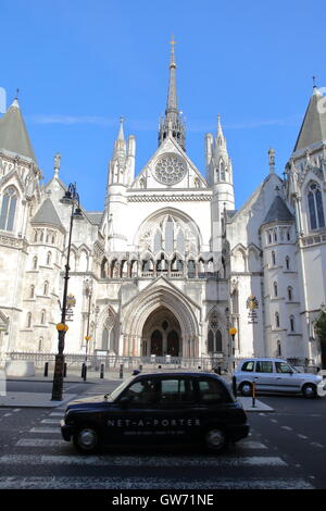 The Royal Courts of Justice from the Strand with cabs on the foreground, London, Great Britain - Stock Photo