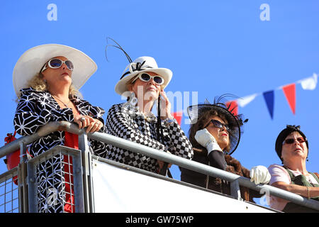 Chichester, UK. 11th Sep, 2016. Spectators in period clothing.  The Goodwood Revival is a three-day festival held - Stock Photo