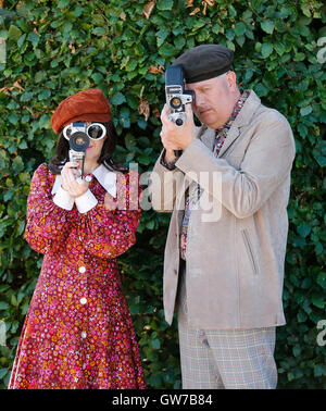 London, Chichester in south UK. 11th Sep, 2016. People in vintage clothes pose with vintage cameras at the Goodwood - Stock Photo