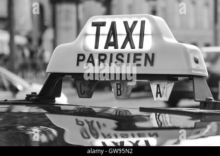 Paris taxi detail and Arc de Triomphe in the background, France - Stock Photo