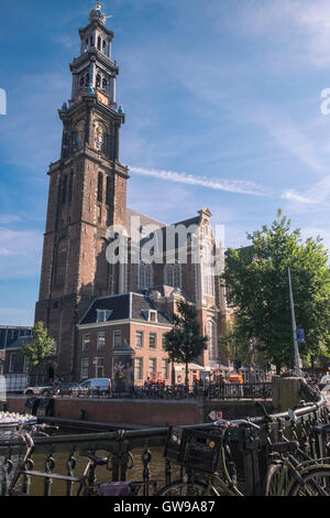 The Westerkerk, a large Protestant church with 85m high tower located on Prinsengracht canal, Amsterdam, Netherlands. - Stock Photo