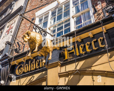 Sign outside 'The Golden Fleece' public house.  It is reputed to be the oldest inn in York, England and York's most - Stock Photo