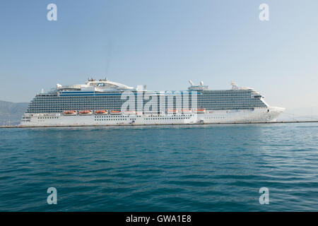 The Royal Princess cruise ship anchored in Corfu port town - Stock Photo