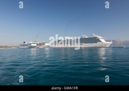 Three cruise ships anchored in Corfu port town - Stock Photo