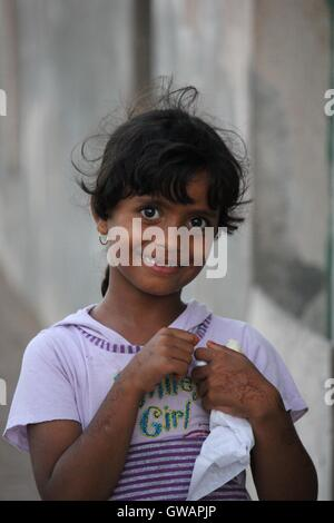 Sur, Oman, October 22, 2013: Little omani girl with henna hands tattoo, looking at me in the camera - Stock Photo