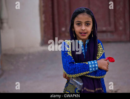 Sur, Oman, October 22, 2013: Little omani girl, looking at me in the camera - Stock Photo