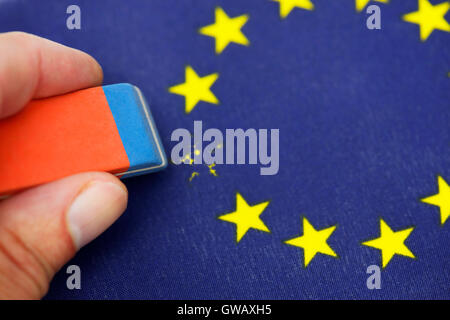 From EU flag star is erased out, symbolic photo Brexit, Aus EU-Fahne wird Stern ausradiert, Symbolfoto Brexit - Stock Photo