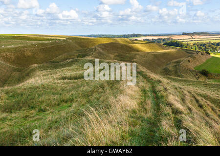 Ditches and ramparts on north side of Maiden Castle - Stock Photo