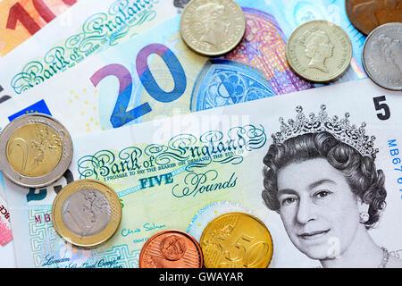 British pound marks and euro-bank notes and Euro monetary coins, Britische Pfundnoten und Euro-Geldscheine und  - Stock Photo