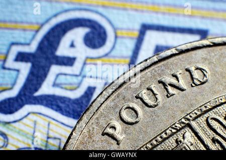 British one-pound coin and pound mark, Britische Ein-Pfund-Muenze und Pfundnote - Stock Photo