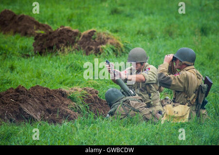 US Army 82nd Airborne mortar team firing a shell. - Stock Photo