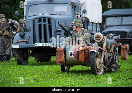 German soldier on BMW R75 Motorcycle. Shot at 'World War 2 Days' history re-enactment event. - Stock Photo