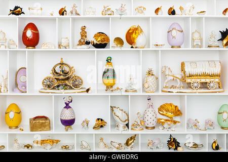 ceramic figurines on the white storefront - Stock Photo