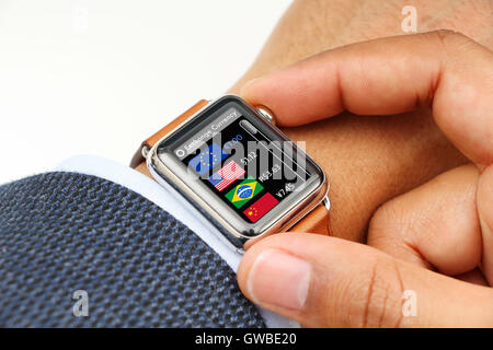 Businessman checking exchange currency through a smart watch app - Stock Photo