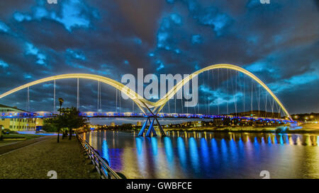 The Infinity Bridge is a public pedestrian and cycle footbridge across the River Tees in the borough of Stockton - Stock Photo