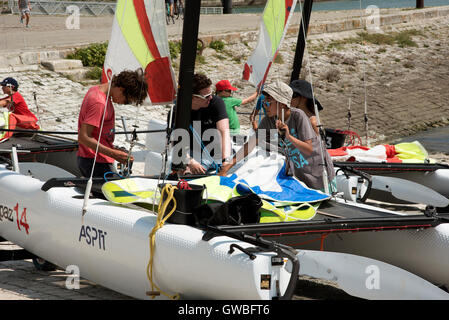 Sailing school in La Rochelle southwest France - Young people learning to sail in the harbor at La Rochelle a French - Stock Photo