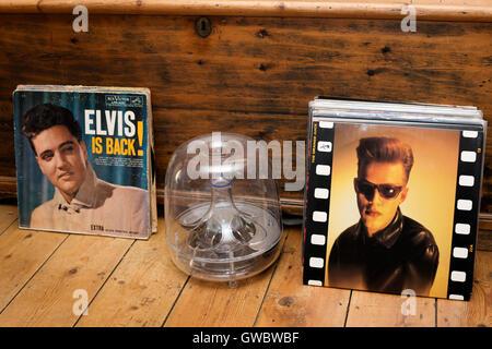 Orange Juice and Elvis presley alums - Stock Photo