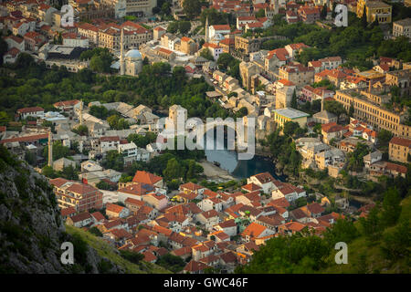 An aerial view of the Neretva river which runs across old Mostar and its Old Bridge (Stari Most). Bosnia Herzegovina - Stock Photo