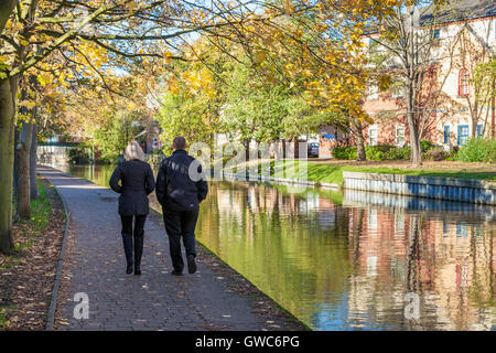 Couple taking an Autumn walk along the Nottingham and Beeston canal in Nottingham, England, UK - Stock Photo