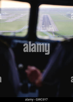 DDA Classic Flights approaches runway 27 at Amsterdam Schipol airport. - Stock Photo