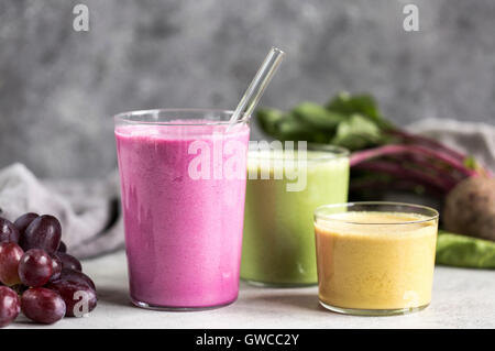 3 glasses of Multi-Colored Beet Smoothies are photographed from the front view. - Stock Photo