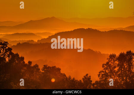Vibrant autumn sunrise in the Smoky Mountains National Park - Stock Photo