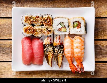 Sushi Set nigiri and rolls on wooden background - Stock Photo